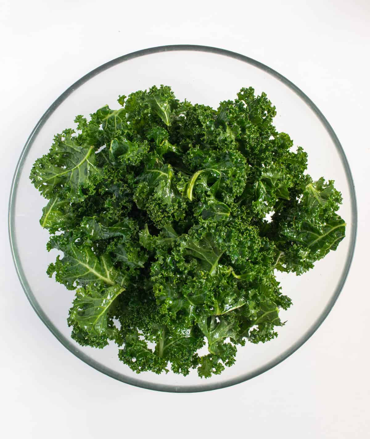 Kale in bowl mixed with ingredients