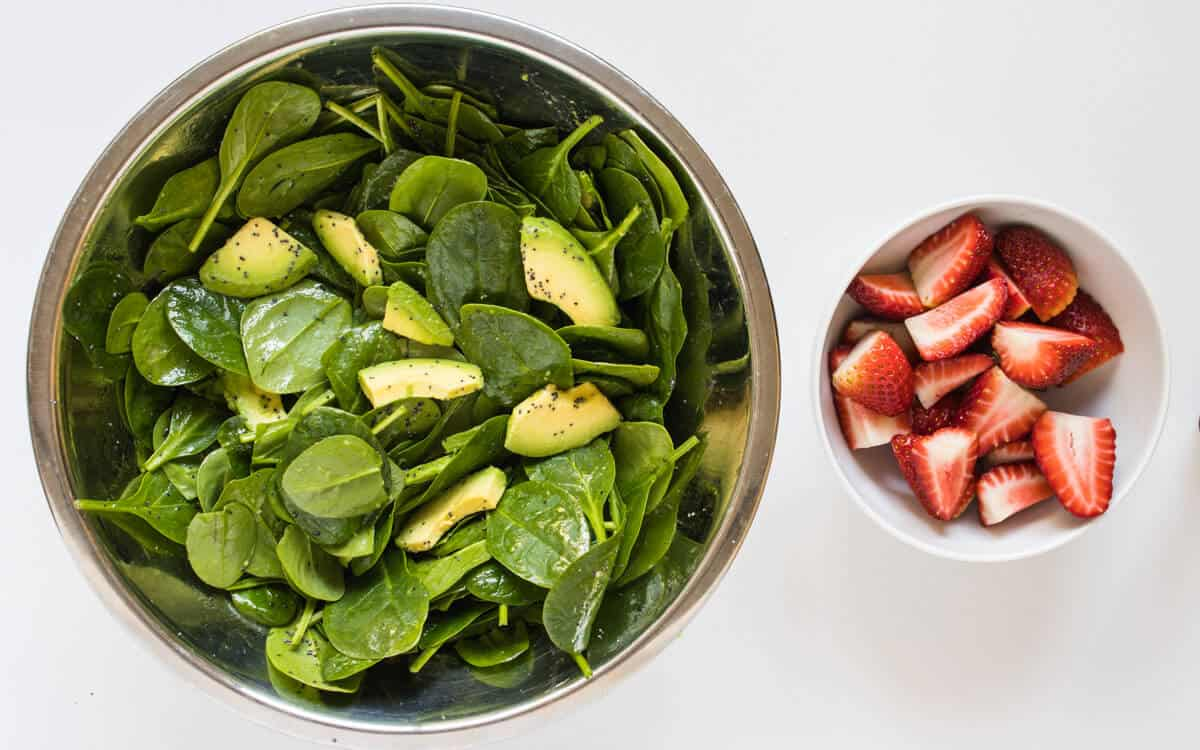 Strawberry Salad ingredients in a mixing bowl