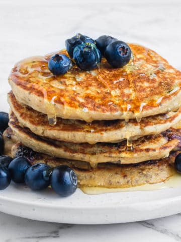 Vegan Blueberry Pancakes served with fresh blueberries