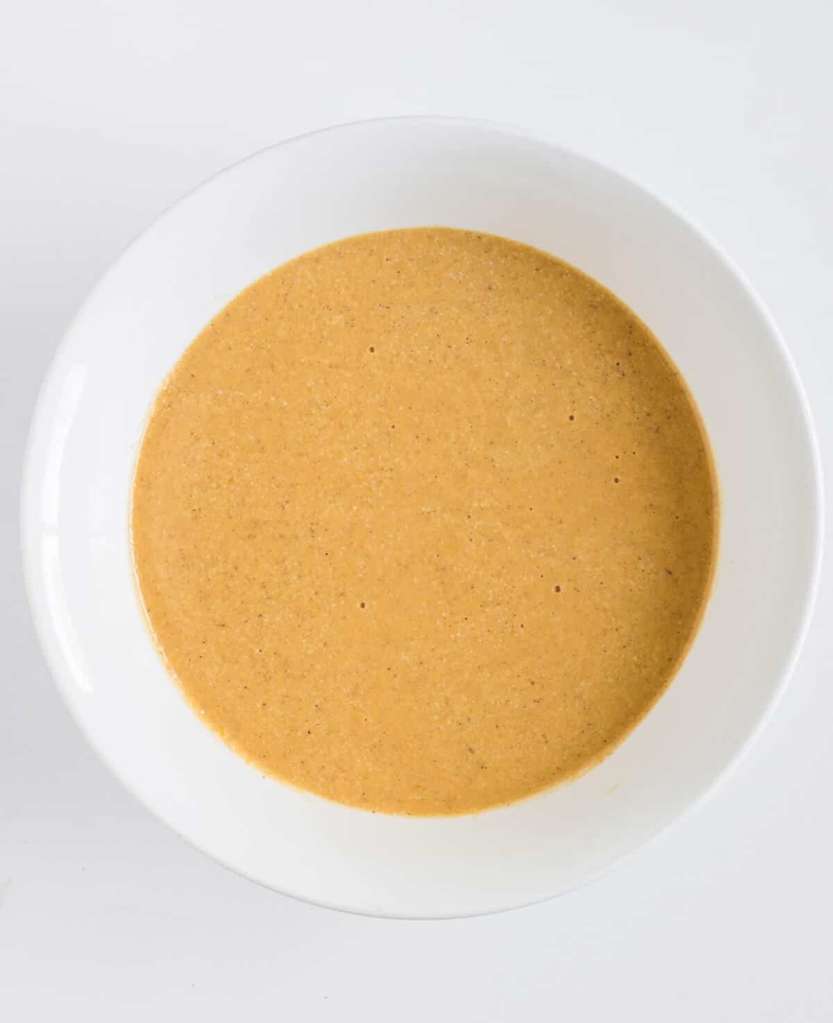Pumpkin pancakes batter in a bowl