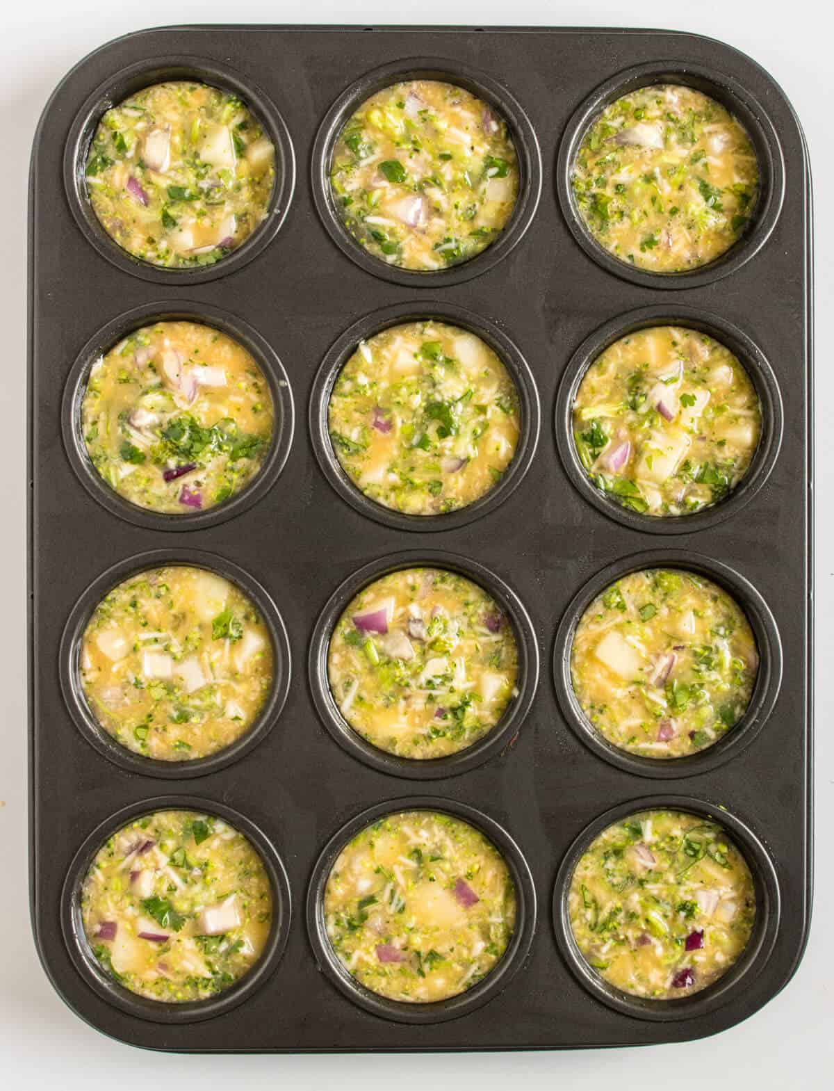 Egg mixture in a muffin tray before going into the oven