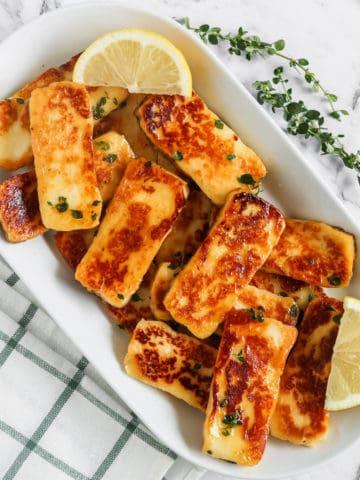 Honey Glaze Halloumi served on a plate with lemon