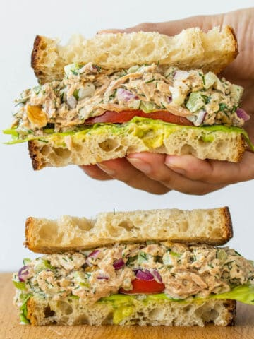 Healthy Tuna Salad sandwich being picked up by hand