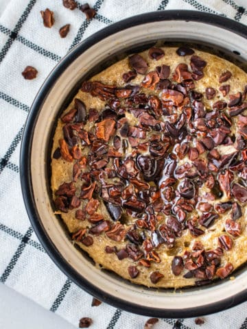Baked Oats Vegan topped with cacao nibs and maple syrup