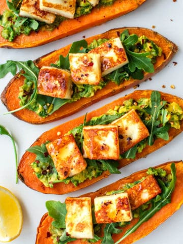 Sweet Potato Toast topped with smashed avocado, rocket salad, halloumi cheese and chilli