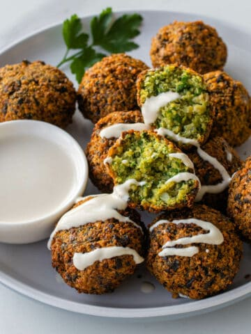 Fried Falafel drizzled with tahini sauce