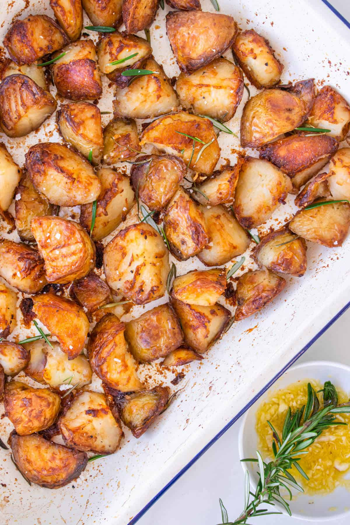 Crispy oven potatoes in an oven tray
