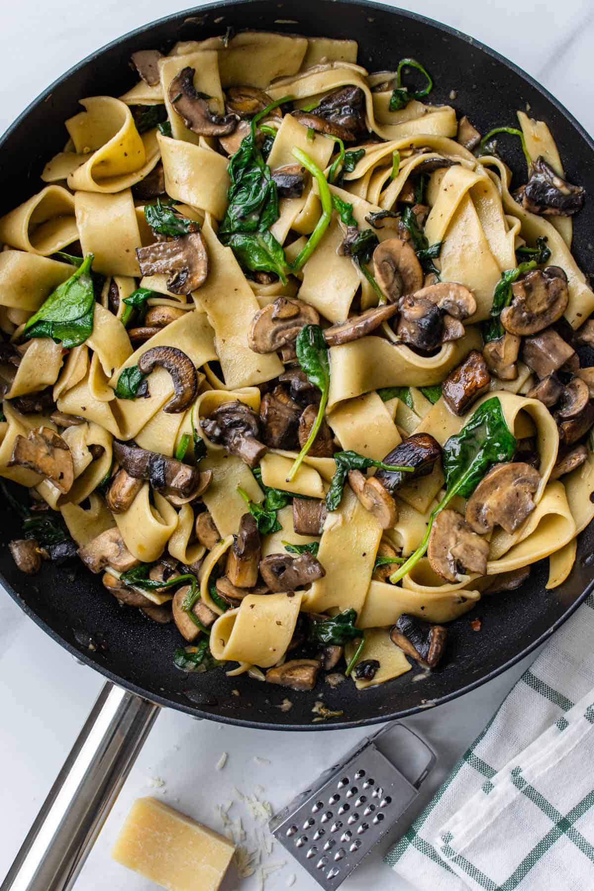 Pappardelle pasta with mushrooms in a pan